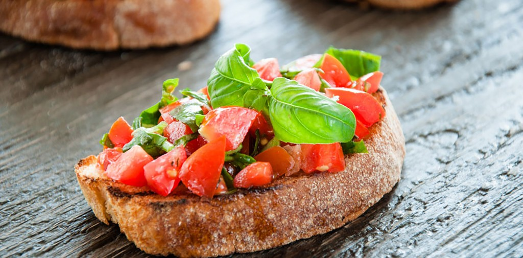 Italian Bruschetta With Chopped Vegetables, Herbs And Oil On Gri
