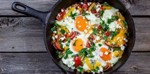 "Eggs Poached With Vegetables,named ""shakshouka"" On Wooden Table."
